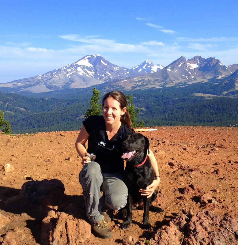 Amy C, on top of a mountain with her very good doggo